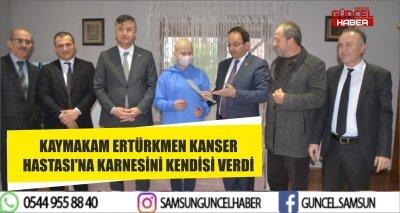 KAYMAKAM ERTÜRKMEN KANSER HASTASI'NA KARNESİNİ KENDİSİ VERDİ