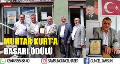 MUHTAR KURT'A BAŞARI ÖDÜLÜ