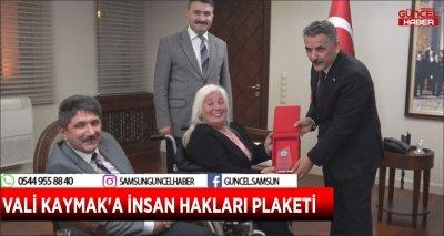 VALİ KAYMAK'A İNSAN HAKLARI PLAKETİ